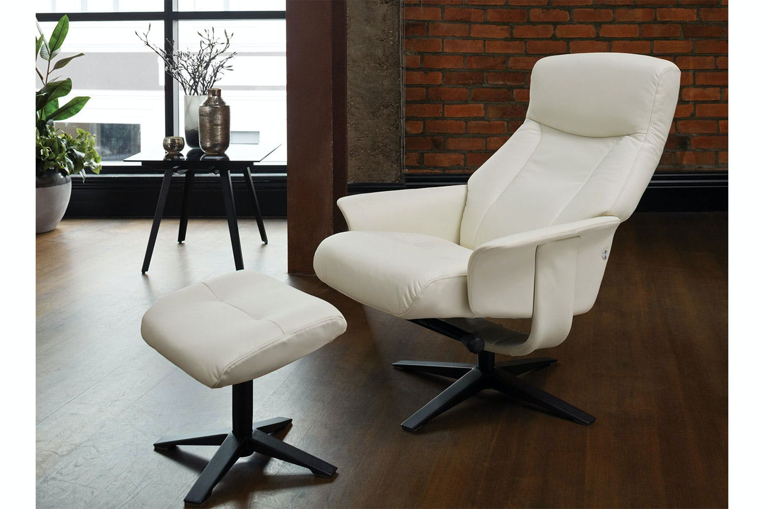 Chena Leather Recliner Chair and Footstool by Debonaire Furniture