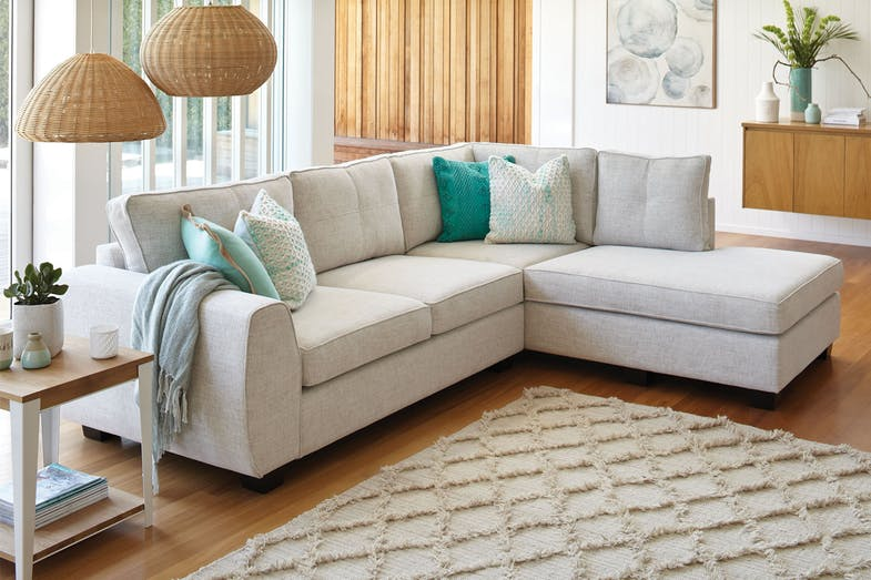 Albany 4 seater fabric sofa with chaise by white rose for Affordable furniture nz